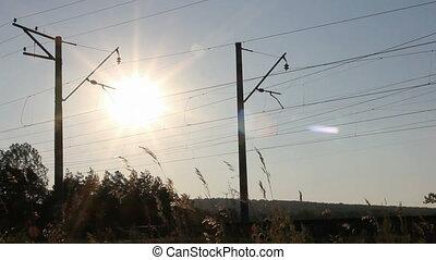 passenger train against sunset