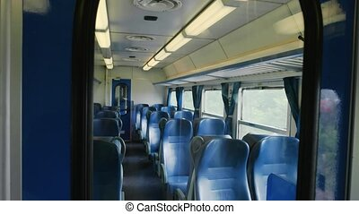 Passenger train wagon interior. Train windows and seats.