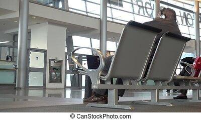 Passenger wait in terminal for flight