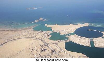 Passenger window view of Pearl Qatar, an artificial island