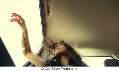 Passenger Woman Leaning Hand On Window And Watching Outside
