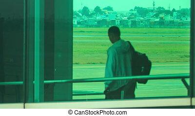 Passengers Board Liner through Loading Bridge in Terminal