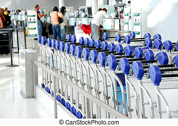 Passengers carts airport - Luggage carts at modern...