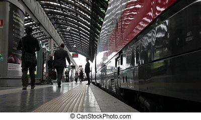 Passengers come in the land to the train. The central...