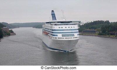 Passengers cruiser float between coastline near Stockholm