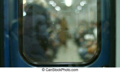 Passengers enter the wagon. Subway station. Peak hour....