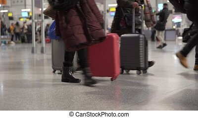 passengers leaving the airport with luggage