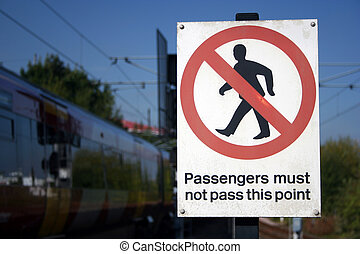 Passengers must not - a railway danger sign with train in...