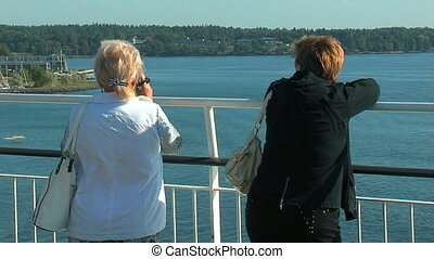 Passengers on the deck of the liner