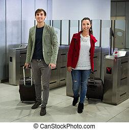 Passengers passing the turnstile