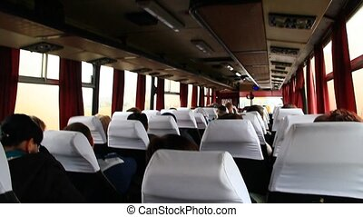 passengers ride in the bus - passengers sit and ride inside...