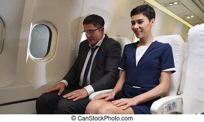 Passengers stretching for muscle relax in airplane . Business trip concept .
