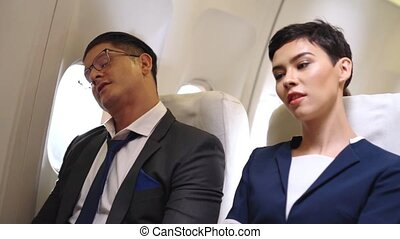 Passengers stretching for muscle relax in airplane