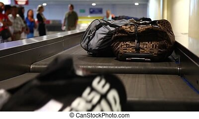 Passengers waiting for their luggag