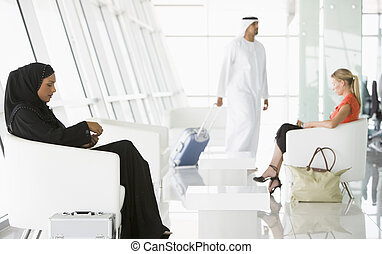 Passengers waiting in airport departure lounge