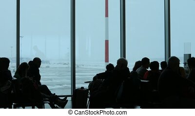 passengers waiting to board are stuck at the airport