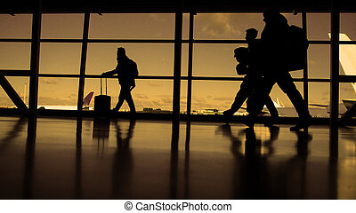Passengers waiting to boarding. A sunny day blue sky on the background, silhouette, warm