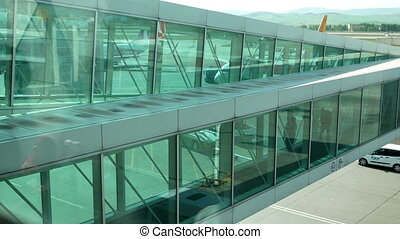 Passengers walking airport - Passengers walking inside the...