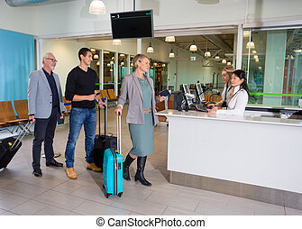 Passengers With Luggage Waiting At Airport Reception - Male...