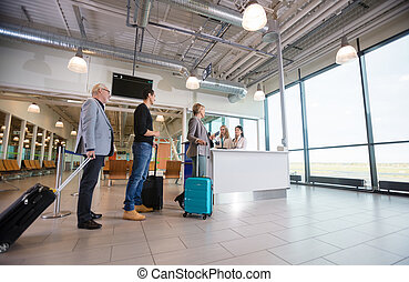 Passengers With Luggage Waiting At Reception In Airport -...