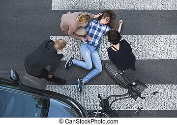 Passersby helping casualty of a car accident