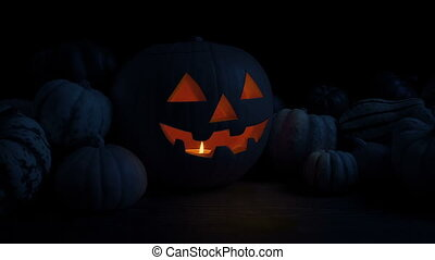 Passing A Halloween Pumpkin Glowing On Table In The Dark