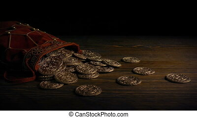 Passing Bag Of Gold Coins On Table