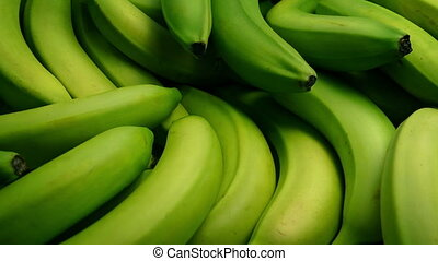 Passing Banana Bunches In Artistic Lighting - Tracking shot...