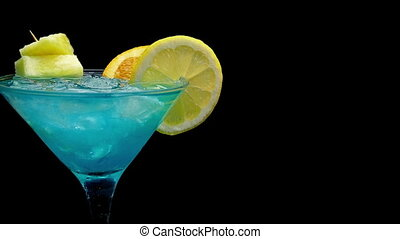 Passing Blue Cocktail With Citrus Fruits - Tracking shot...