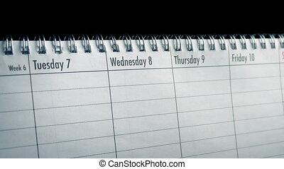 Passing Calendar Days Closeup - Tracking shot moving slowly...
