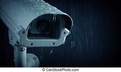 Passing CCTV Camera In Heavy Rain - Tracking shot passing a...