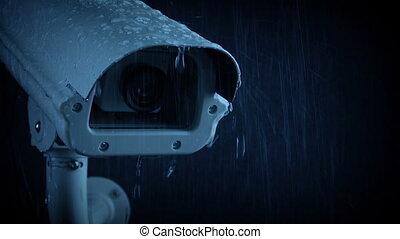 Passing CCTV Camera On Rainy Evening - Tracking shot passing...