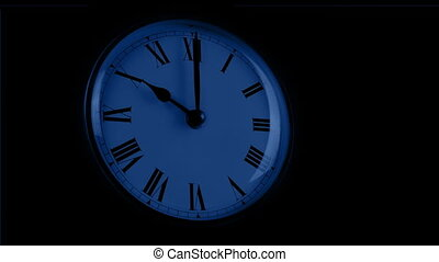 Passing Clock Face In The Dark - Moving past a wall clock in...