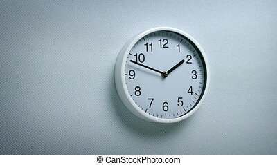Passing Clock On Wall In Generic Environment - Tracking shot...