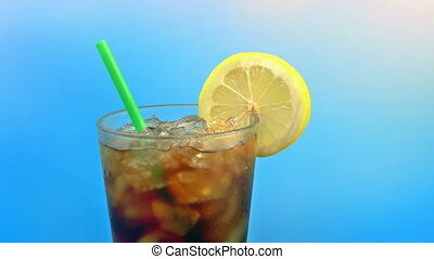 Passing Coke With Lemon On Sunny Day