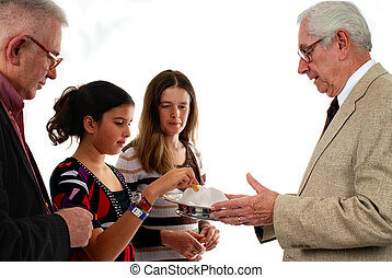 Passing Communion - A senior man passing the communion bread...