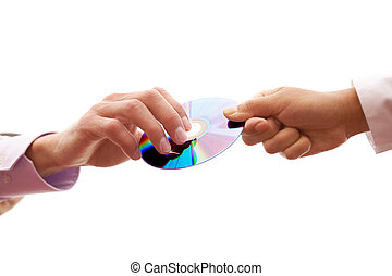 Passing compact disc - Close-up of human hand passing cd to...