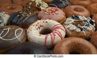 Passing Delicious Mixed Donuts - Moving slowly over many...