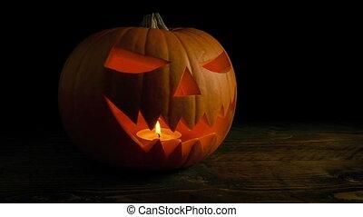 Passing Glowing Jack-O-Lantern - Traditional carved pumpkin...