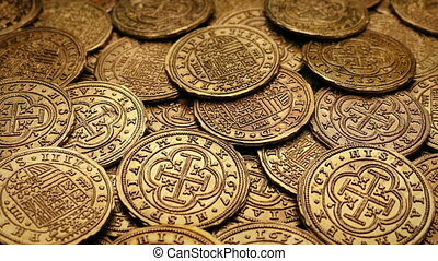 Moving closeup of ancient gold coins