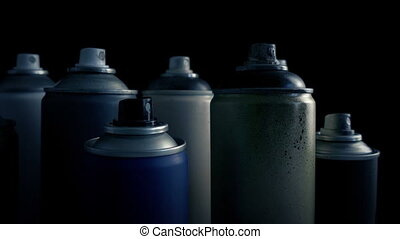 Passing Grungy Used Spraypaint Cans - Slider shot moving...