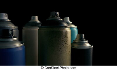 Passing Grungy Used Spraypaint Cans - Slowly moving past...