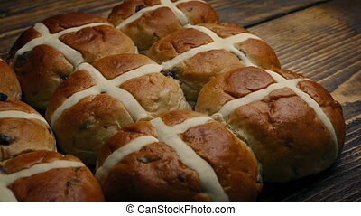 Passing Hot Cross Buns On Wooden Table