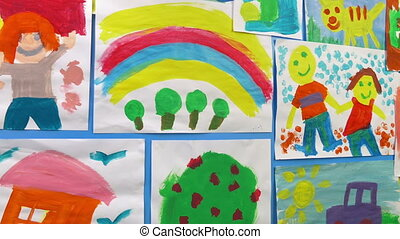Passing Kid's Paintings On Wall - Tracking shot moving past ...