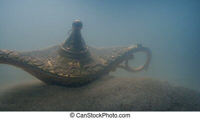 Passing Old Lamp In The Sand Underwater - Passing an ancient...