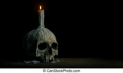 Passing Old Skull With Candle Melted On It