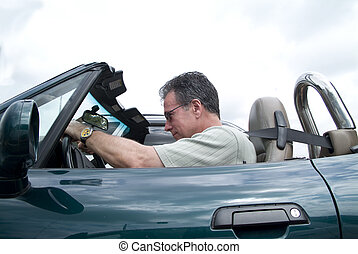 Passing on the left. - A man in a convertible sports car...