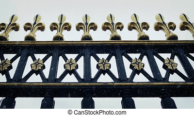 Passing Ornate Metal Railings With Snow Falling - Panning...