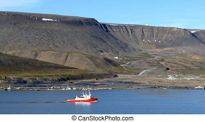 passing plataberget, a table mountain, during cruise through fjord near longyearbyen in svalbard