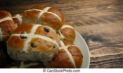 Passing Plate Of Hot Cross Buns On Table